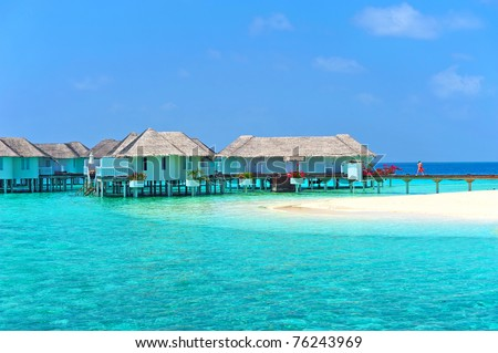 Maldive water villa - bungalows and white beach - stock photo