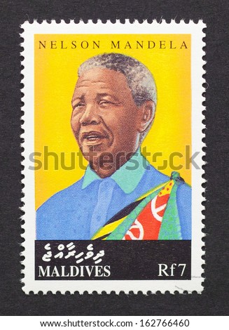 MALDIVES - CIRCA 1998: postage stamp printed in Maldives showing an image of Nobel Peace prize winner Nelson Mandela, circa 1998.  - stock photo