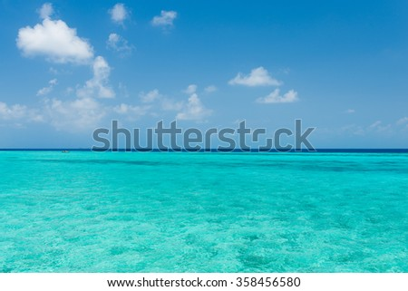 Maldives. Island in the ocean.  Turquoise water of the lagoon. - stock photo