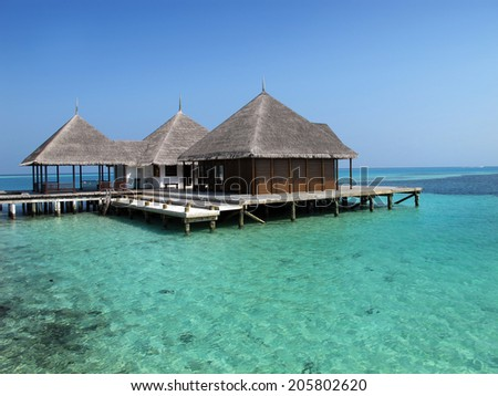 maldives island with clear water and bungalow                                 - stock photo