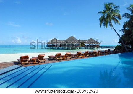 maldives resort - cafe and swimming pool on the tropical beach - stock photo