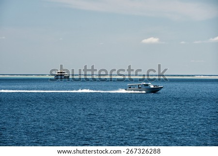 maldives tropical paradise resort blue water reef - stock photo