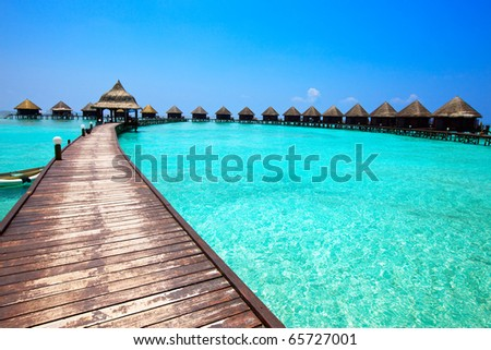 Maldives.  Villa on piles on water - stock photo
