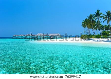 Maldives water villa - bungalows and white beach - stock photo