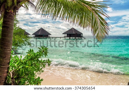 Maldivian beach overlooking the water bungalows