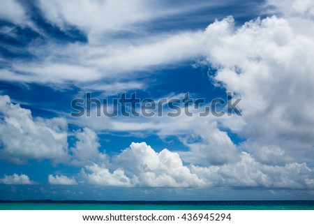Maldivian Tropical seascape. Cloudy sky over calm ocean. Beautiful day in Paradise Summer sky and beautiful beach of Maldives - stock photo