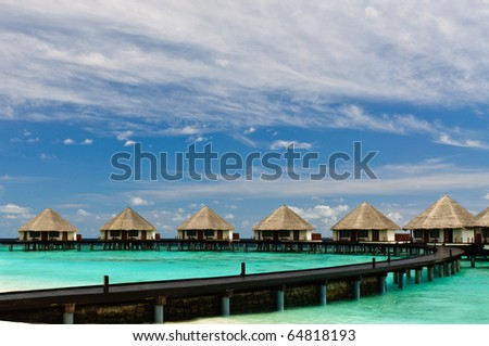 Maldivian water bungalows. - stock photo