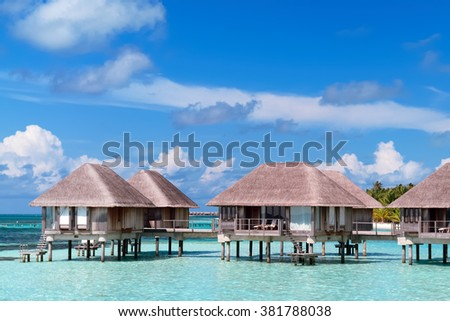 Maldivian water bungalows with blue sky and sea.