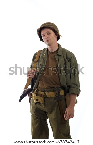Male actor in military uniform of an American Marine of the Second World War period posing against a white background