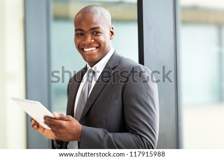 male african american office worker with tablet computer - stock photo