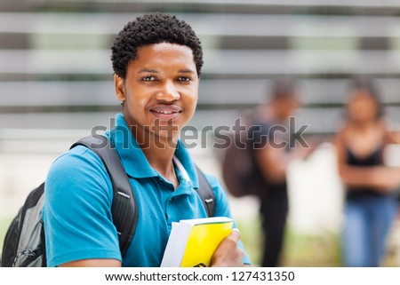 male african college boy portrait outdoors - stock photo