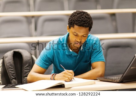 male african college student in lecture room - stock photo