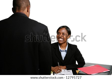 Male and female business colleagues chatting and smiling. Horizontal shot, isolated against a white background