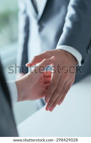 Male and female business people shaking hands before the meeting - stock photo