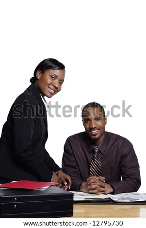 Male and female businesspeople smiling at the camera. Isolated on white.