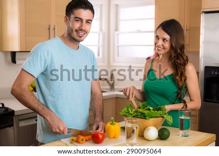 Male and female chef learn and teach each other how to cook a healthy meal - stock photo