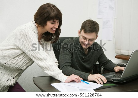male and female colleagues in the office at work