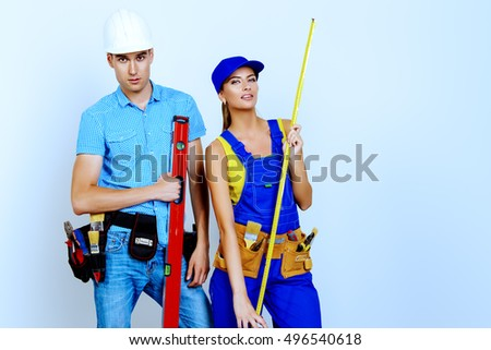 Male and female construction workers. Smiling young couple in love is going to renovate their new apartment. Copy space.