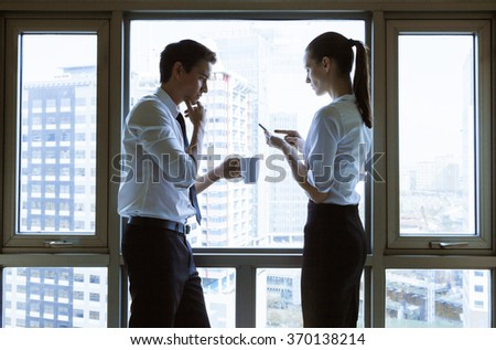 Male and female discussing business.  - stock photo
