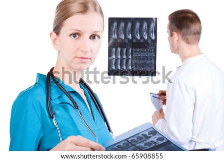 Male and Female Doctors examining MRI images - stock photo