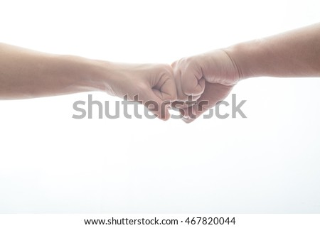 male and female doing fist bump
