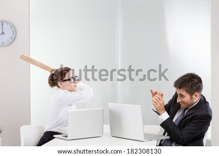 Male and female executives staring each other down  - stock photo