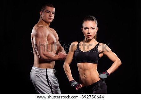 Male and female fitness models. Young muscular couple. Muscular arms and lean torso. Building the dream. - stock photo