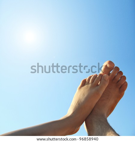 male and female foot high direction sky - stock photo