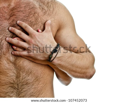 Male and female hand on the man's chest. Isolated on white.