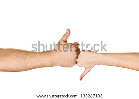 male and female hand showing thumbs like and dislike on white background