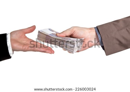Male and female hand with a wad of Russian money - stock photo