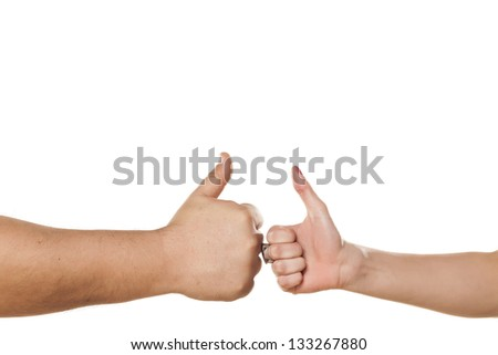 male and female hand with ring showing thumbs up on white background