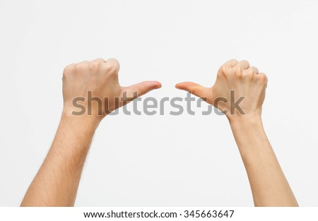 Male and female hands showing different direction, white background