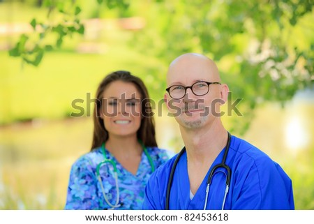 male and female healthcare professional - stock photo