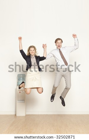 male and female professional happy and jumping - stock photo