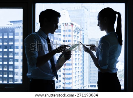 Male and female working in the city. - stock photo