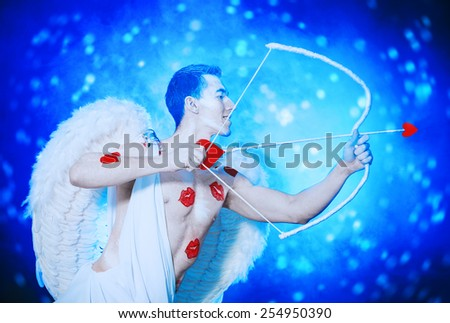 Male angel Cupid with a bow and arrows of love. Valentine's day. Love concept. - stock photo