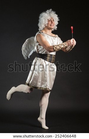 Male angel Cupid with a love heart. Valentine's day - stock photo
