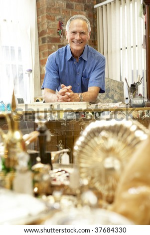 Male antique shop proprietor - stock photo