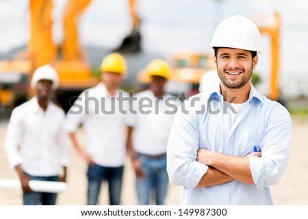 Male architect at a construction site looking happy