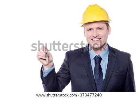 Male architect holding house key over white - stock photo