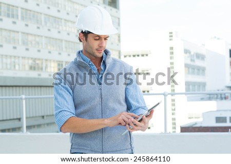 Male architect using digital tablet outside building - stock photo