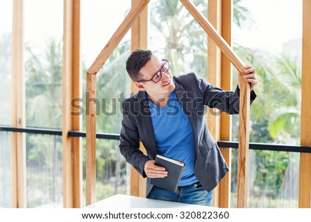 male architect working on a house model