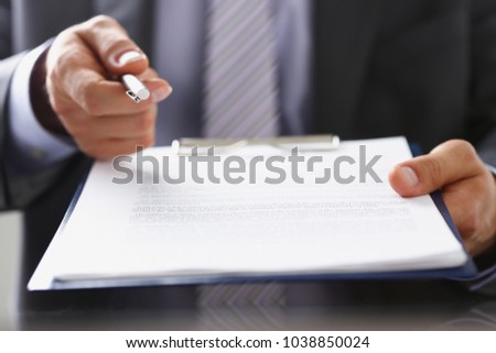 Male arm in suit offer contract form on