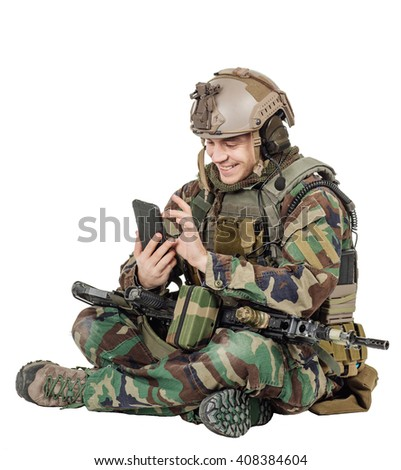 male Army soldier wearing camouflage on his mobile cell phone.war, army, weapon, technology and people concept. Image on a white background. - stock photo