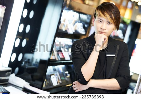 male asian chinese seller portrait in make-up beauty saloon shop