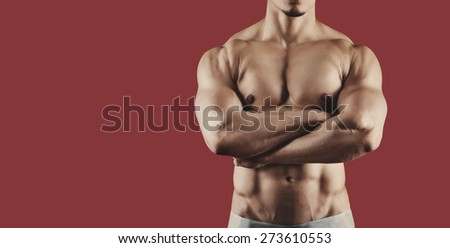 Male athlete. Bodybuilder isolated on the background