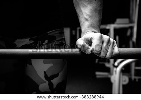Male athlete in the gym doing exercises - stock photo