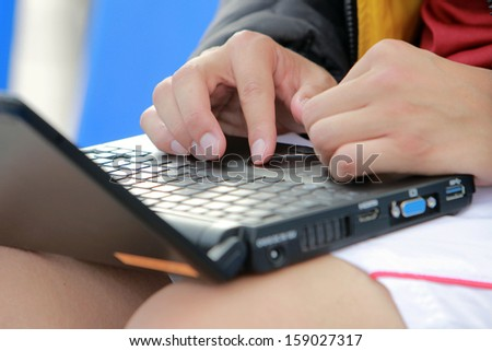 male athlete with a laptop on his knees