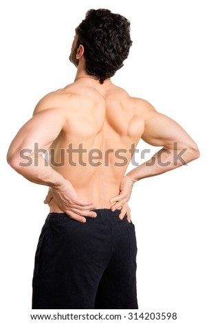 Male athlete with pain in his lower back, isolated in white